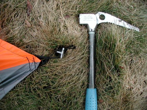Stake out the four corners. Use a small loop of replaceable cord so wear from rough stake edges will not damage the tent web tie outs.