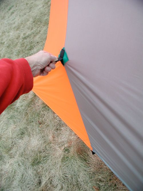 Additional tie outs can be staked around the hem and the upper center tie outs can be used to gain headroom in windy or heavy snow conditions.
