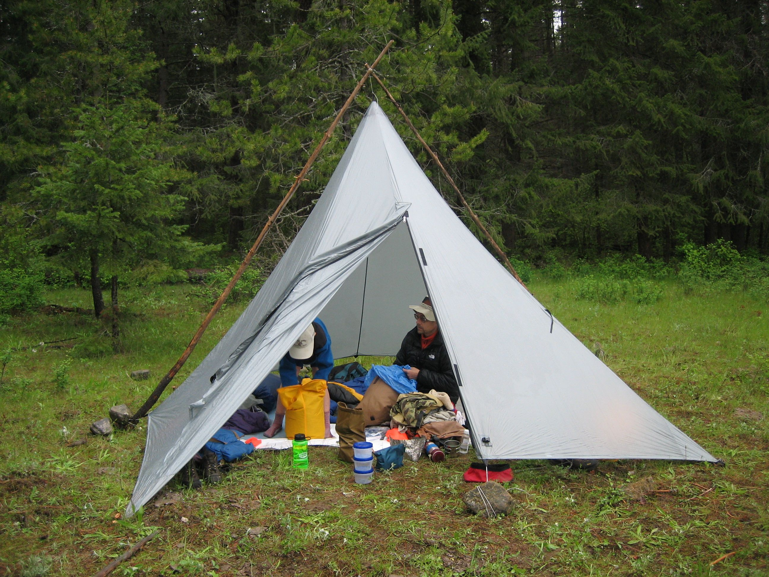 Two wooden poles can be lasted to hold the tarp up from outside. & pyramid tarp | Oware