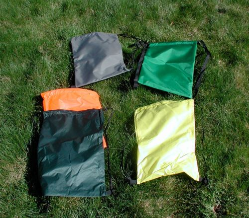 Clockwise from top left. 210d Foliage Green, 420d  grass green, 70d silnylon yellow, 30d silnylon dark forest, 30d silnylon blaze orange.