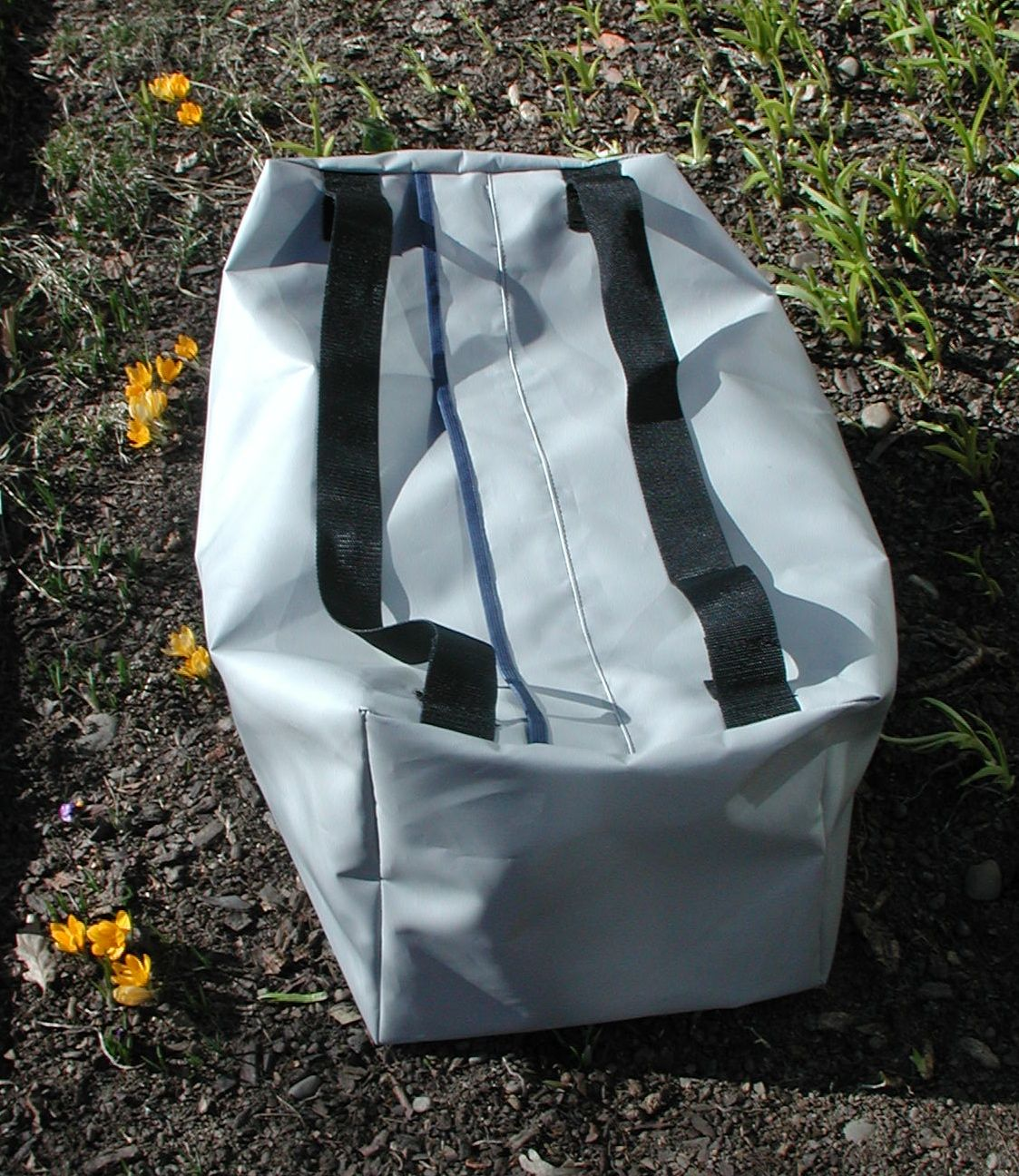 Truck tarp reinforced vinyl duffle. Handles work as shoulder straps. Number 10 zipper. 5000 cu inches.Uses as sled bag for ski patrol, drillers. conservation corp and wild land  fire fighters gear bag. Custom orders.