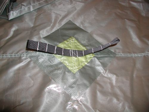 patch for holding paddle or pole under tarp on silicone coated ultralight nylon